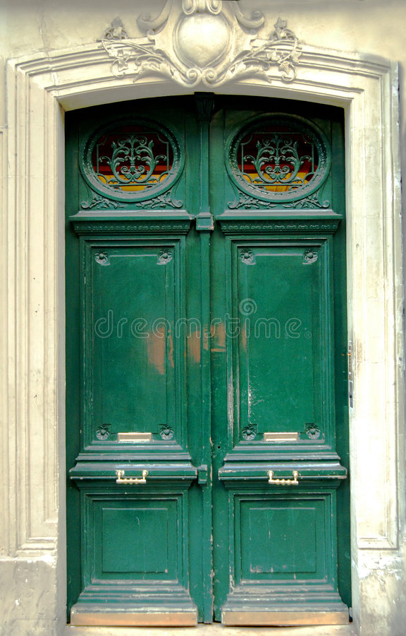 Green Door. Closed wooden green door on wall royalty free stock photos