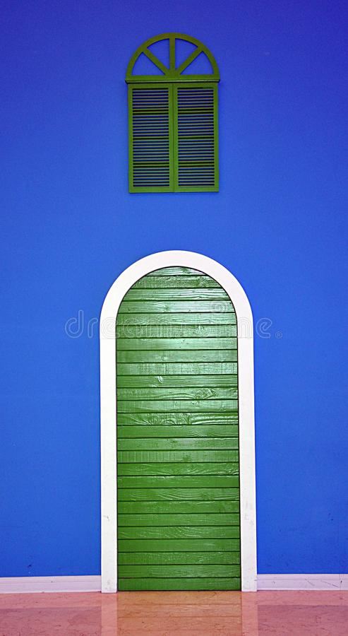 Green door and blue wall. Look at the green door and blue wall stock photography