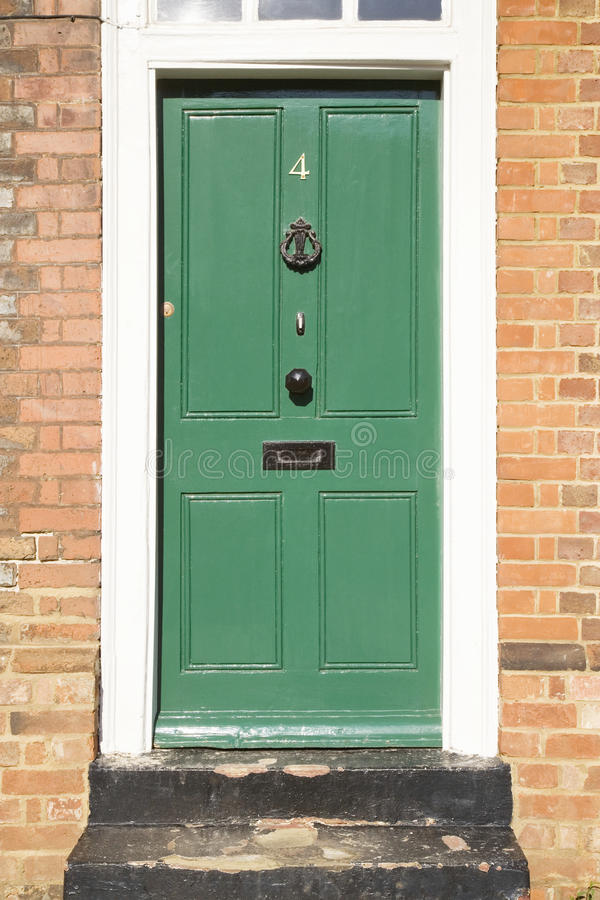 Free Green Door In A Brick Building Royalty Free Stock Photo - 13658445