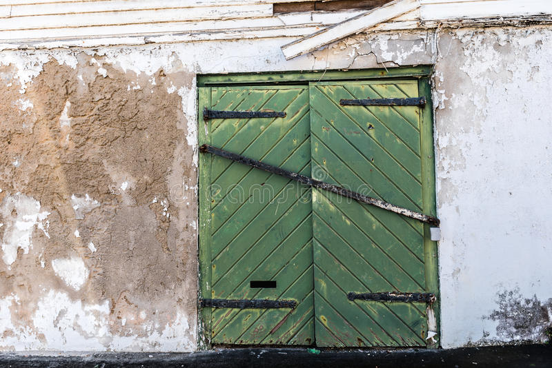 Green door with iron hardware royalty free stock images