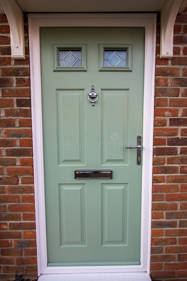 Green door. Modern house composite UPVC front door royalty free stock photography
