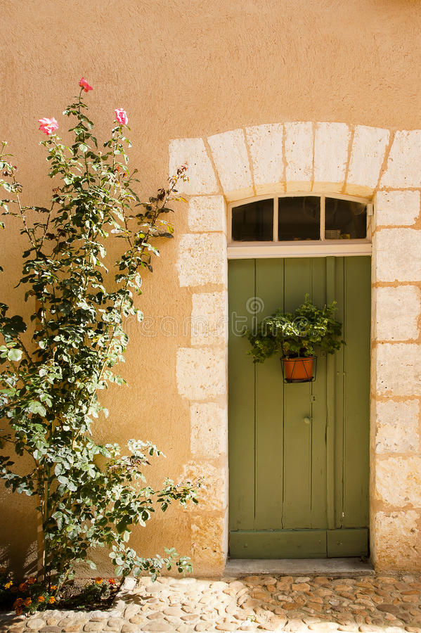Green door Saint Jean de Cole France stock image