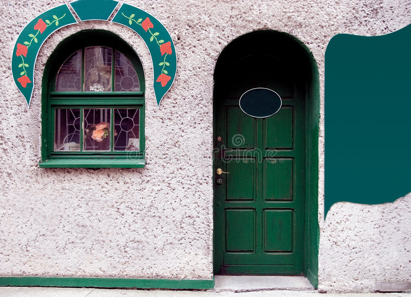 Green door and window. Decorative ornament, copy space at the right royalty free stock photo