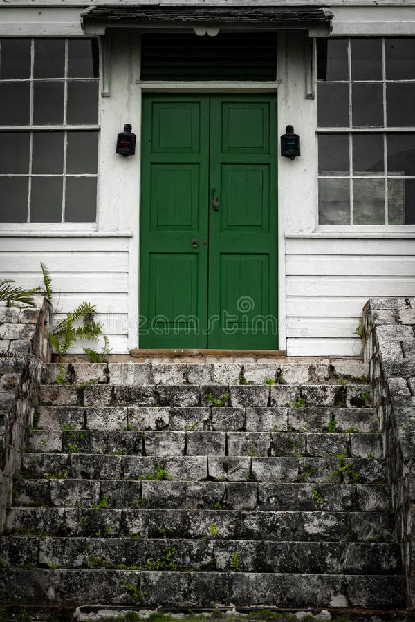 Green double door front entrance at top of stairs/ staircase at a vintage house/home stock photos