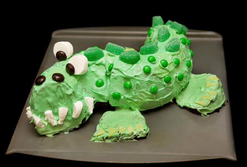 Green dragon cake. One large green dragon cake made of marshmellow, candies and spearmint gum royalty free stock photo