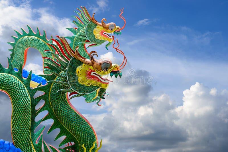 Green dragons on beautiful blue sky. Green dragons on beautiful blue sky background stock photography
