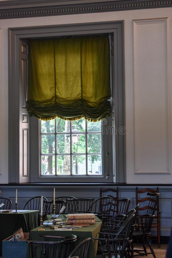 Green drape hanging in a window in the Assemble Room of Independence Hall. Inside of Independence hall of Philadelphia, Pennsylvania. The green drapes of a stock photo