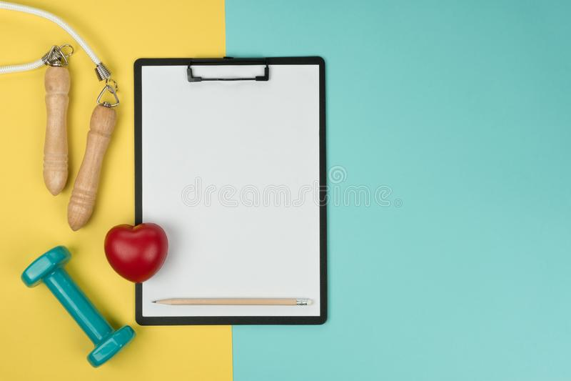 A green dumbbell and jump rope stock images