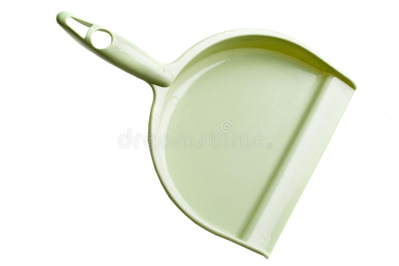 Green dust pan stock image