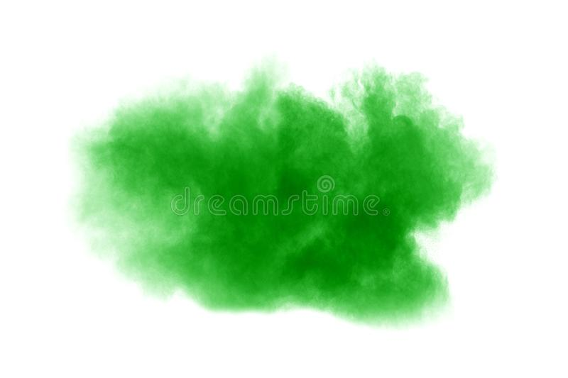 Green dust particles explosion on white background. Color powder dust splash.  royalty free stock photos