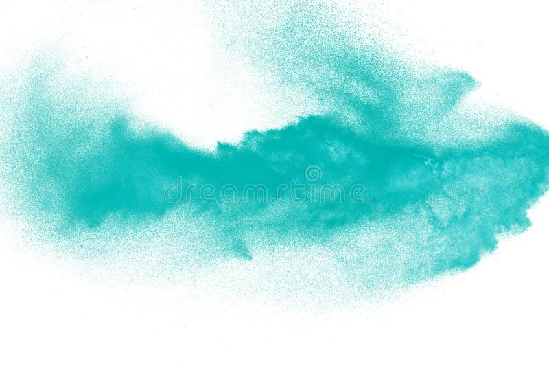 Green dust particles explosion on white background. Powder dust splash. On background royalty free stock images