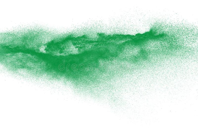 Green dust particles explosion on white background. Powder dust splash on white background stock photo