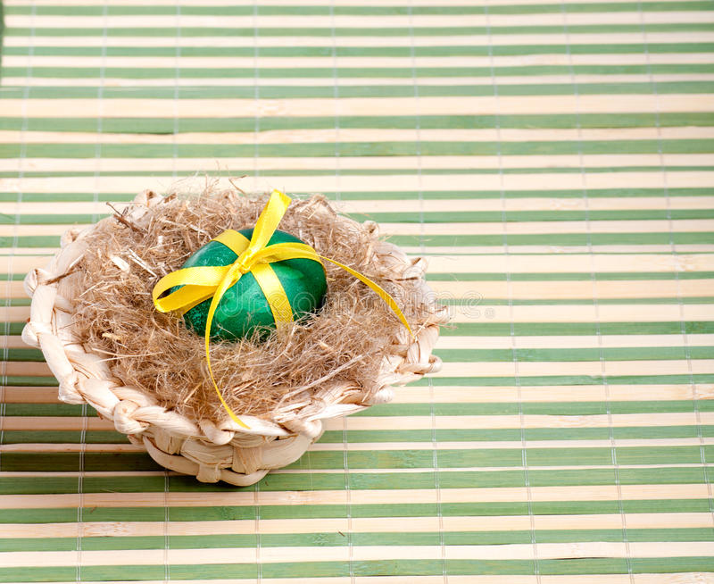 Download Green Easter Egg In A Straw Hat Stock Image - Image: 29008791