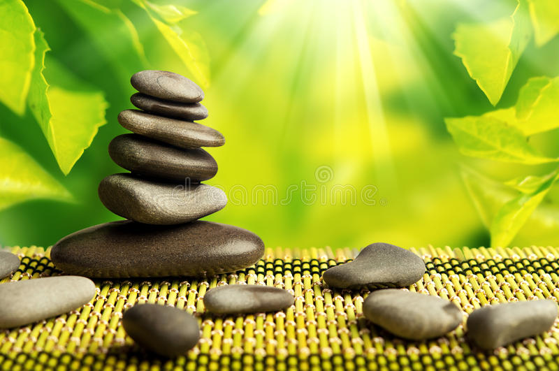 Green eco background, spa stones and leaves royalty free stock photos
