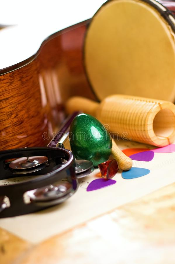 Green egg shaker among other instruments royalty free stock photo