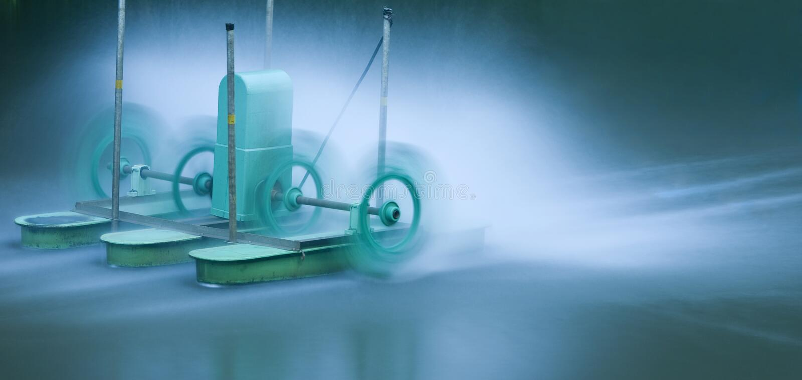 Green Electric Aerator For Water Treatment Stock Photos
