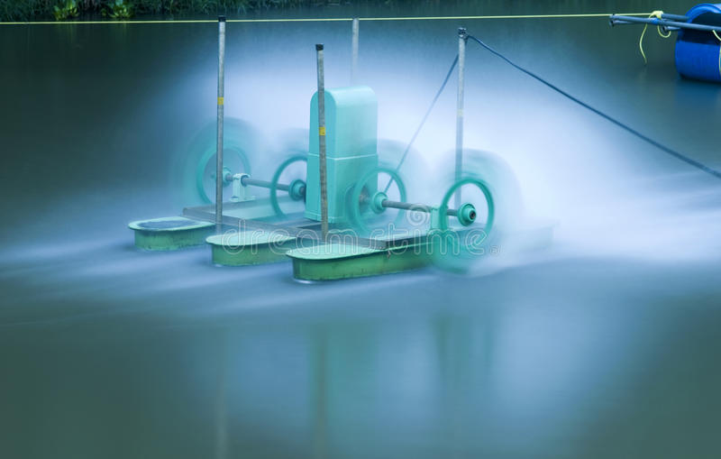Green electric aerator for water treatment stock photography