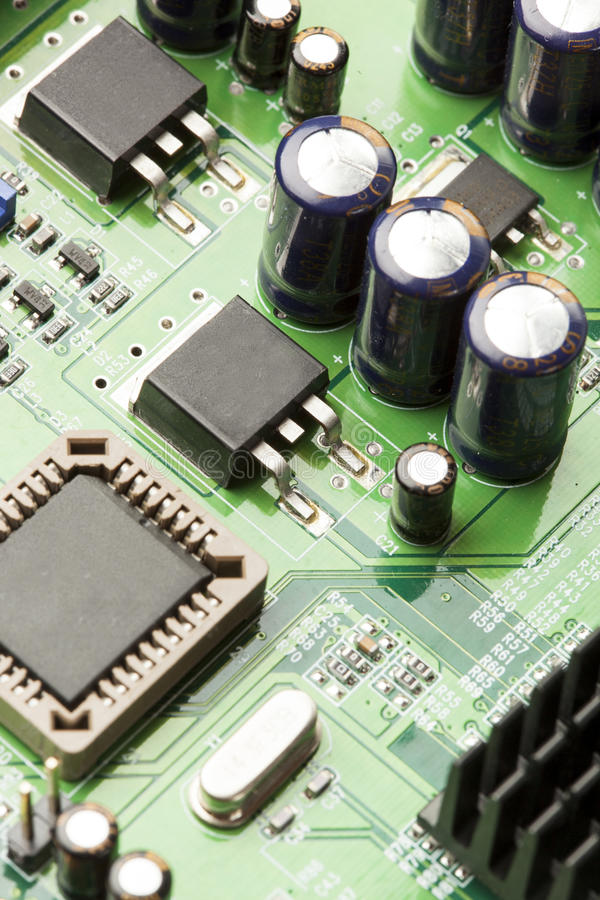 Green Electrical Circuit Board with microchips and transistors. Green Electrical Circuit Board with microchips, conductors, and transistors stock photos