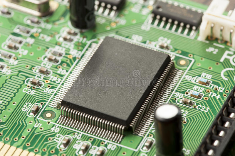 Green Electrical Circuit Board with microchips and transistors stock photography
