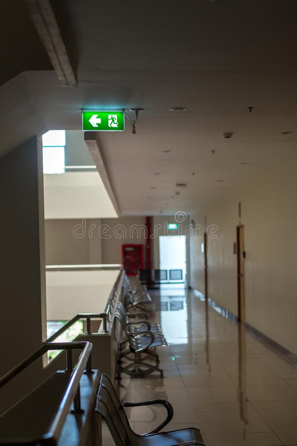 Green emergency exit sign showing the way to escape.Fire exit in the building. royalty free stock images