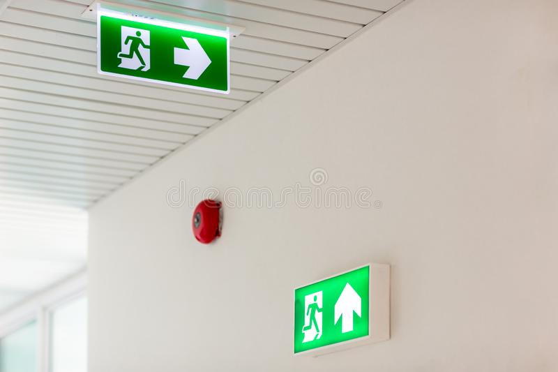 Green emergency exit sign showing the way to escape.Fire exit in the building royalty free stock photography