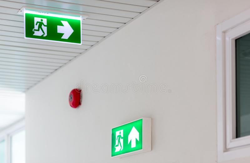 Green emergency exit sign showing the way to escape.Fire exit in the building stock images