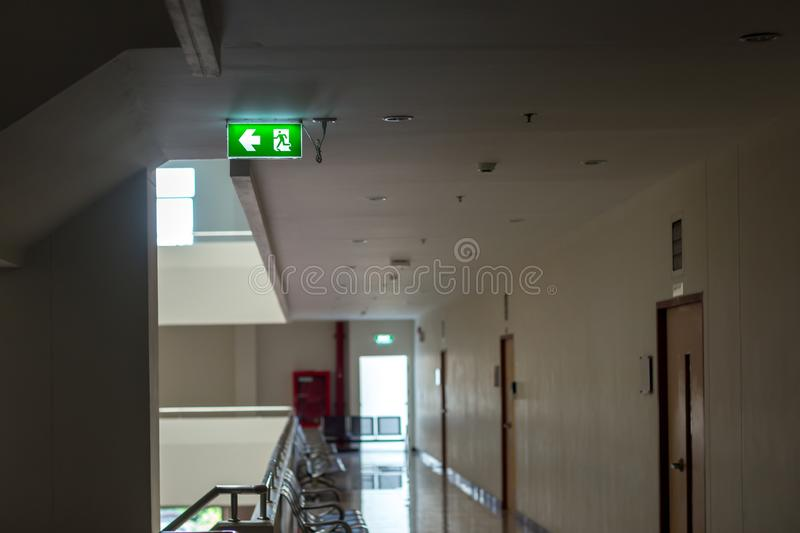 Green emergency exit sign showing the way to escape.Fire exit in the building. stock photos