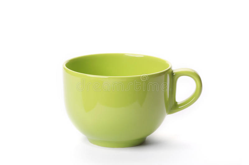 Green empty cup. On a white background stock photography