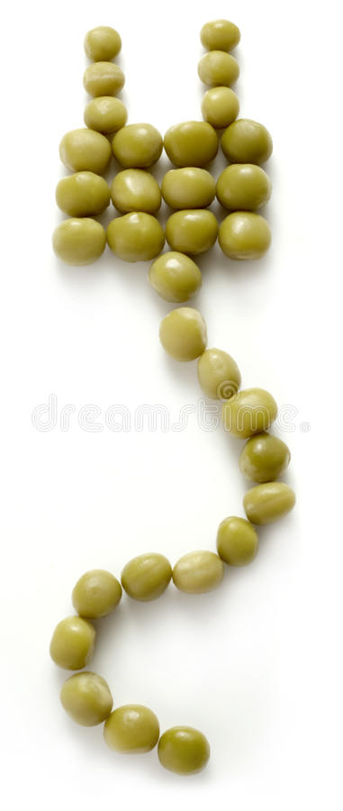 Green enegry. Green peas plug isolated on a white background royalty free stock photography