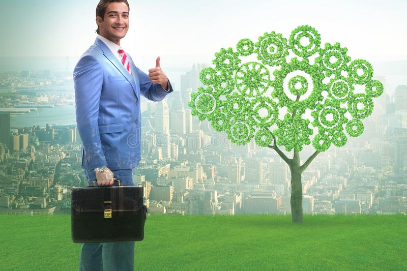 Green energy anc ecology concept with businessman stock image
