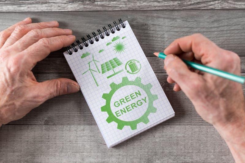 Green energy concept on a notepad stock photos