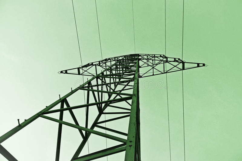 Green Energy - Powerline Pole. Powerline Pole Against a Green Background - Symbol for Green Energy stock photography