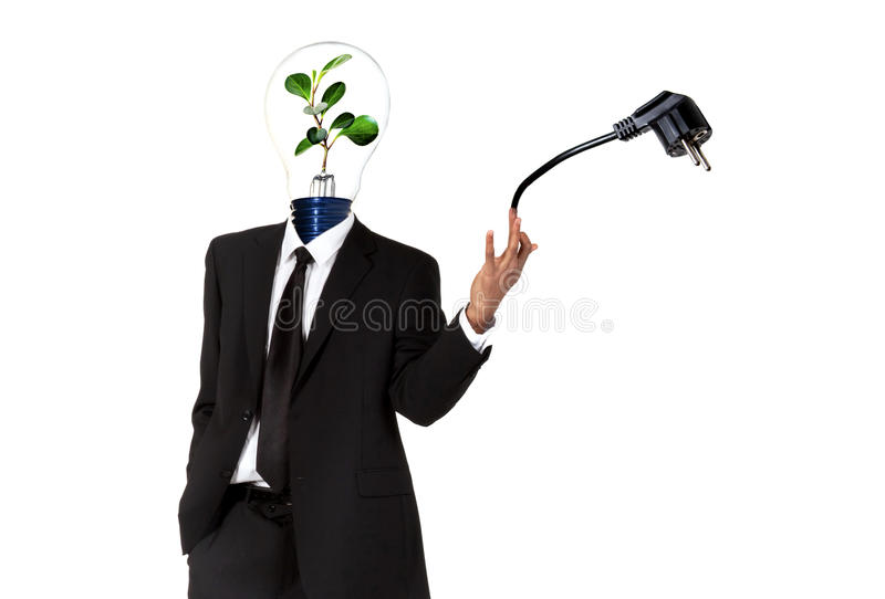 Green energy symbol. Man with green light bulb head and pin plug stock images