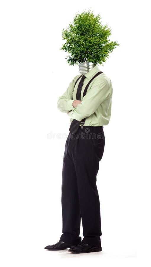 Green energy symbol. Man with green light bulb head stock image
