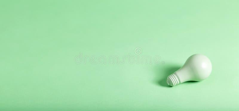 Green energy theme with green light bulb stock photo