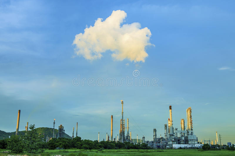 Green environment of heavy petrochemical industry plant against. Blue sky royalty free stock images