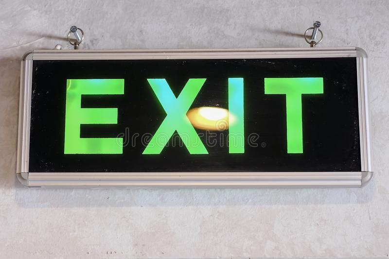 GREEN EXIT SIGNAGE SIGN NEONBOX ON WALL stock images