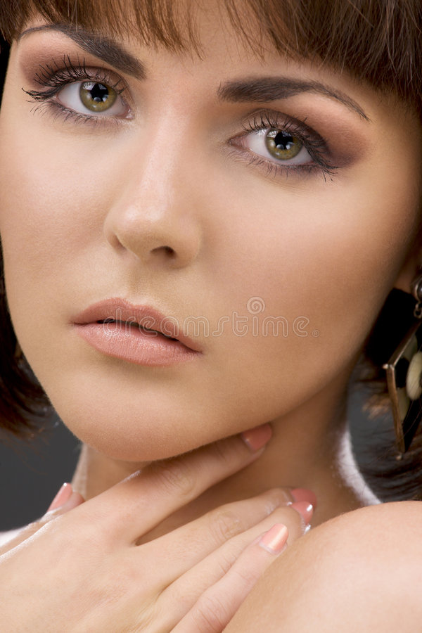 Green-eyed beauty stock images