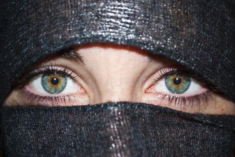 Green eyes with veil