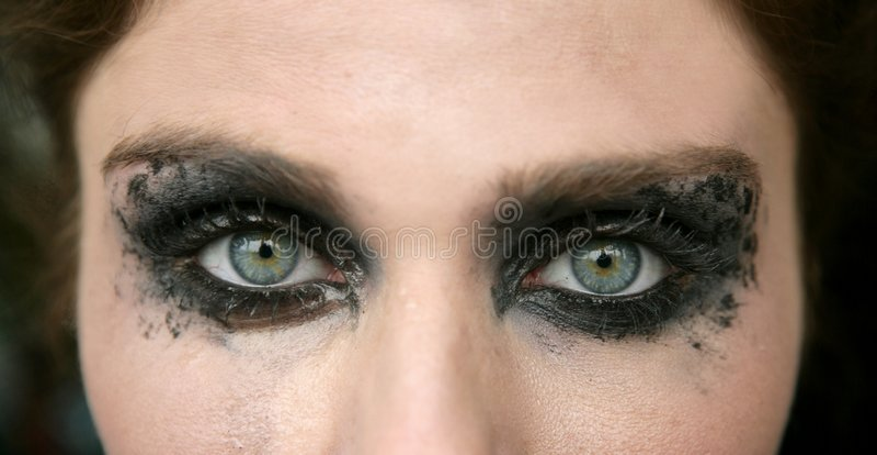 Green eyes woman, black makeup eye shadow stock photography