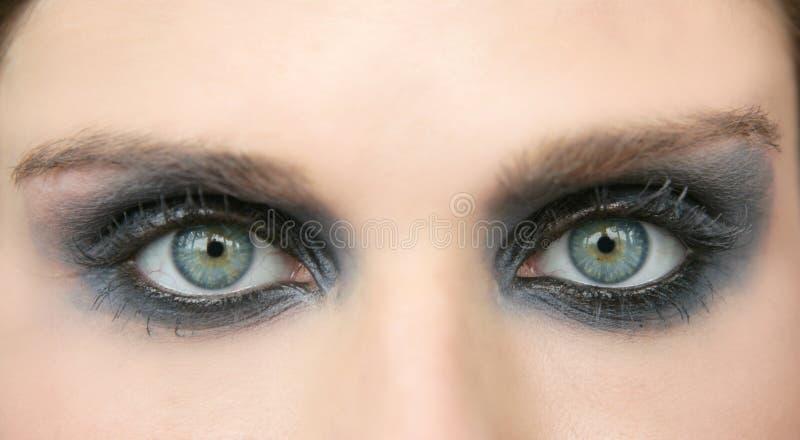 Green eyes woman, black makeup eye shadow royalty free stock image