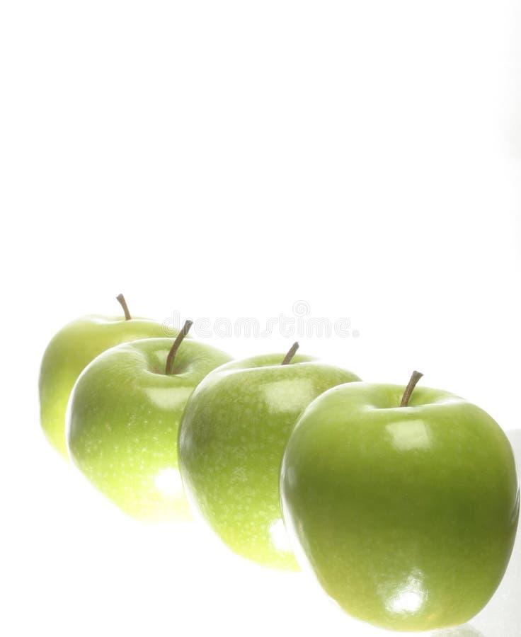 green för äpplen fyra royaltyfria foton