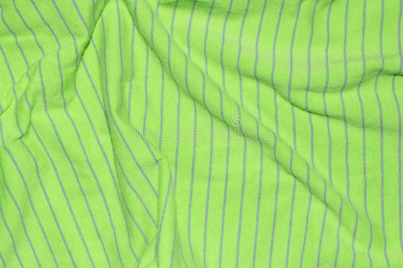 Green fabric with gray stripes.  stock photos