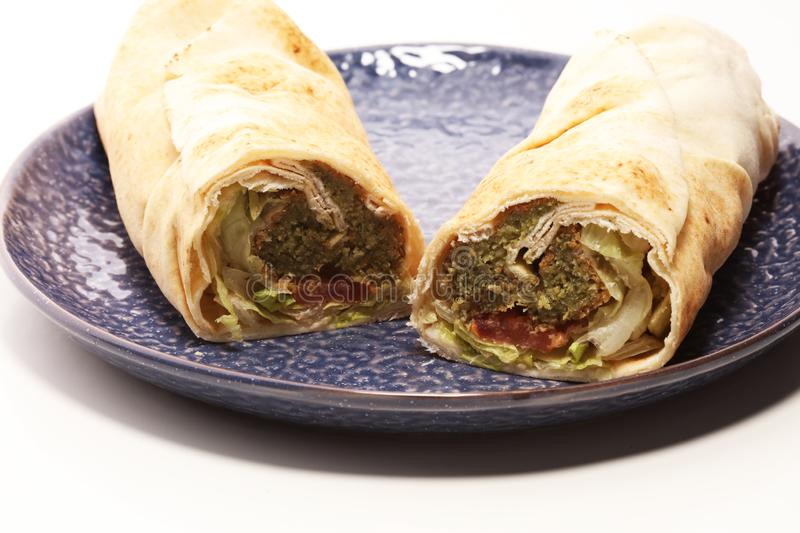 Green falafel with hummus and vegetables in pita bread. Love for stock photos