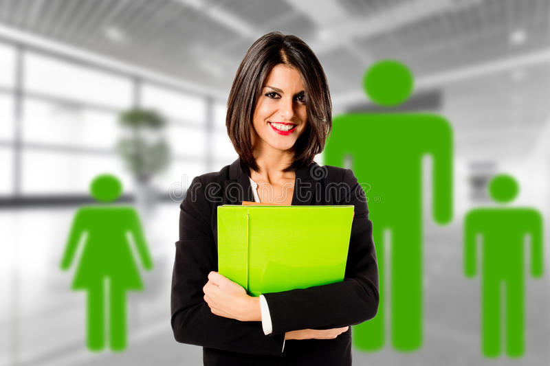Green family business. Smiling happy business woman in her office for green family economy royalty free stock photo