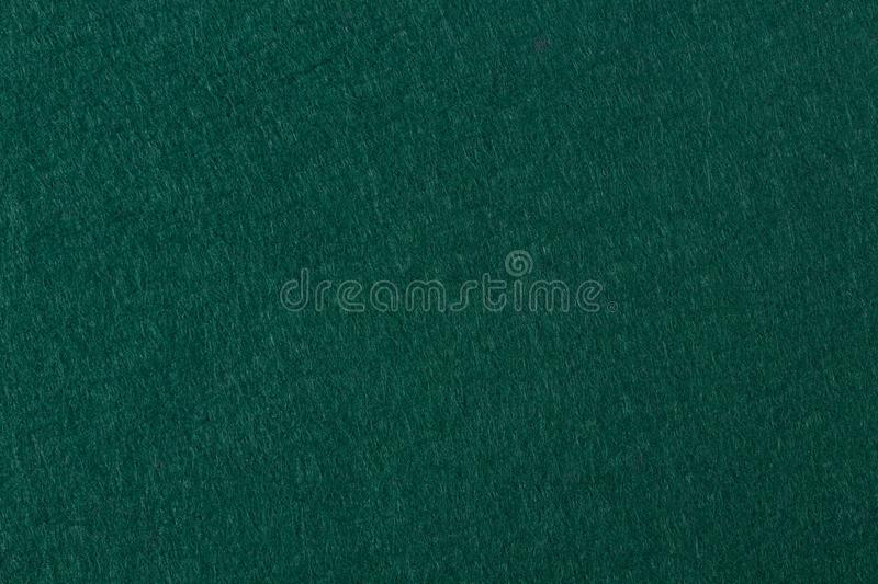 Green felt background. Useful for poker table or pool table surf stock photo