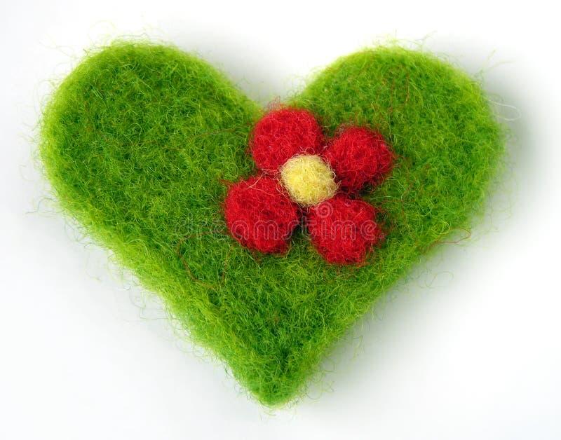 Green felt handmade heart stock photo