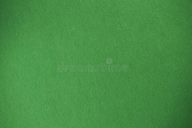 Green felt texture background the woven fabric isolated.  royalty free stock image