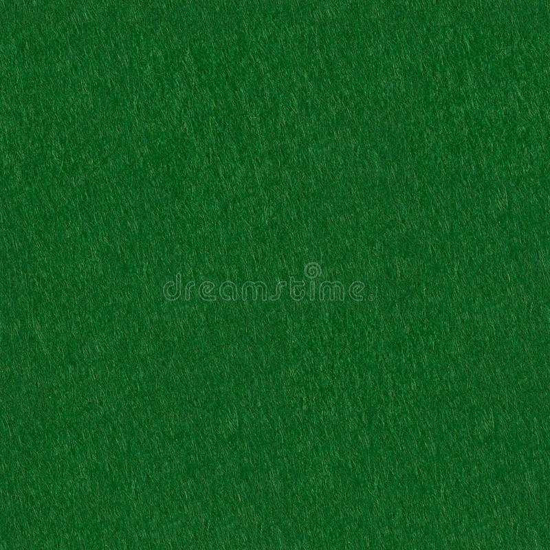 Green felt texture for poker an casino theme. Seamless square background, tile ready. High resolution photo stock image