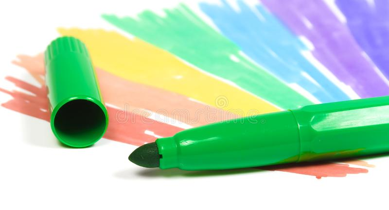 Green felt-tip pen with removed cap